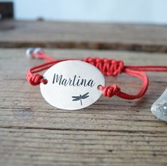 """Custom sterling silver bracelet. In the example, """"martina"""" with a dragonfly."""