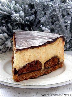 Sernik pomarańczowo cynamonowy na spodzie brownie. http://gotowaniecieszy.blox.pl/2012/11/Pomaranczowy-sernik-na-cynamonowym-brownie.html