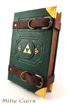 Hylian travelers journal by MilleCuirs equipment gear magic item Create your own roleplaying game material w RPG Bard Writing inspiration for Dungeons and Dragons DND D. The Legend Of Zelda, Cthulhu, Games Memes, Geek Stuff, Link Zelda, Shadowrun, Geek Out, Gi Joe, Bookbinding