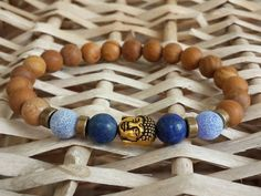 Hey, I found this really awesome Etsy listing at https://www.etsy.com/listing/463519996/buddha-bracelet-wood-gemstone-bracelet