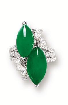 JADEITE AND DIAMOND RING Set to the centre with two marquise-shaped jadeite cabochons decorated by briolette diamonds, the triple-split shoulders set with circular-cut diamonds. (Sotheby's)