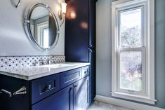 Navy blue is a classic color that is both timeless and sophisticated. A relative of black, navy adds just a hint of mystery and intrigue that isn't found in its much-darker cousin. Learn all the perks of navy cabinets in our latest blog!  #navybluekitchencabinets #navycabinets #navybluebathroom #navybluekitchen #navykitchenisland #navykitchendecor #navybathroomideas #navybathroomvanity Navy Blue Kitchen Cabinets, Navy Cabinets, Shaker Kitchen Cabinets, Bathroom Cabinets, Navy Blue Bathrooms, Navy Bathroom, Cabinet Inspiration, Bathroom Inspiration, Bathroom Ideas