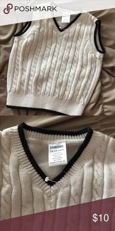 Gymboree Sz: 18-24 month sweater vest NEW! White Gymboree Sz: 18-24 month sweater vest NEW! White and navy! The plastic part of the tag is still connected. Never worn & so cute! Perfect for Christmas or holiday events! 🎄❤️️⛄️️ Gymboree Shirts & Tops Sweaters