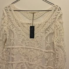 """Lace Top/Dress with Lining This is such a pretty dress! Looks really good with leggings and boots!! I would wear this as a top because it's too short on me, but is a 33"""" length and could be worn as a dress depending on height! Dresses"""