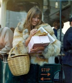 Jane Birkin and her signature basket bag - even in the winter. #signaturestyle #icons #fur New on JNSQ.