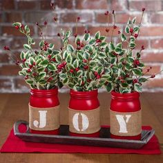 "This ""Joy"" Mason Jar Tablescape DIY can be created in minutes! Paint Mason Jars with Red Montana Gold Spray Paint. Tip: Prep mason jars by washing them in warm water. make sure they are completely dry then spray paint them, its best to do multiple layers allowing each coat to dry. While you are allowing …"