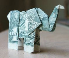 Elephant money! Think this link might be broken, but instructions can be found here: http://www.ehow.com/how_7519831_fold-money-look-like-elephant.html Elephant Art, Elephant Wallet, Elephant Stuff, Elephant Crafts, Origami Elephant, Elephant Love, Baby Elephants, Viviane, Fold Dollar Bill