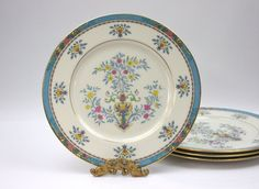 Quite fashionable is this vintage Lenox Blue Tree patterned fine porcelain china . There are 4 dinner plates in a vibrant, turquoise, pinks and
