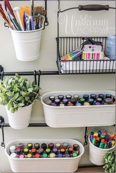 Store art supplies in hanging buckets from IKEA for easy craft room organization. Craft room ideas