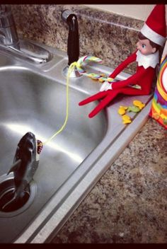 The elf pulled a shark out of the sink!