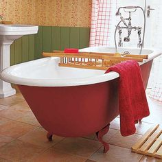 Other claw-foot tubs pale in comparison to this soaker's sensual red coating. | For a shade similar to shown, try: Rave Red, @Sherwin-Williams