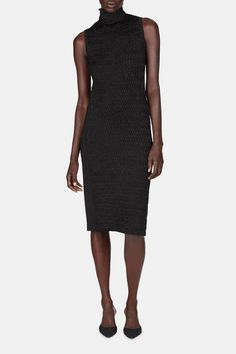 Each Edun piece represents the label's mission to support the artisans and entrepreneurs of Africa, and is also a versatile creation of the highest quality that can be worn in a variety of ways. That principled versatility is demonstrated by this sleeveless dress. In a strikingly textured stretchy knit, it combines a lean silhouette with pull-on ease. The turtleneck is softened by a ruffled lettuce edge.
