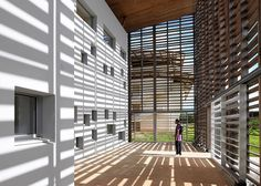 University library by RH+ Architecture encased within a timber lattice