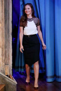 Minka Kelly wore an optic white Michael Kors top with black lace detail, black draped skirt and black belt all from the Resort 2014 collection for an appearance on Late Night with Jimmy Fallon on October 30, 2013 in New York City. #michaelkors