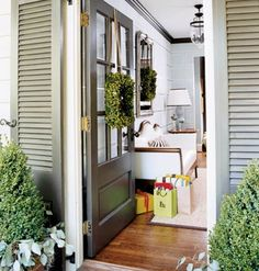 Love the shutters flanking the front entry and the boxwoods.