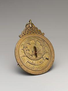 Astrolabe of 'Umar ibn Yusuf ibn 'Umar ibn 'Ali ibn Rasul al-Muzaffari; Yemen, 1291. Brass, cast & hammered, pierced, chased, inlaid with silver. Metropolitan Museum of Art