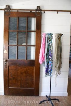 Vintage door on track to slide open. Saves room and adds interest.