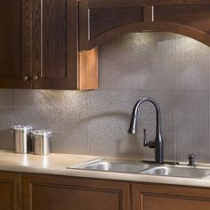 The backsplash panels are easy to install and can be cut with a scissors or tin snips to create the fit that you require. 6-inch x 6-inch samples are available for purchase.