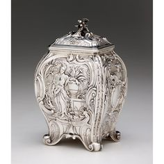 George II silver tea caddy   Alexander Johnston, London, 1755-56   Bombe form on scroll feet decorated with Chinoiserie motifs and figures throughout.