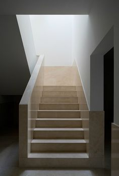 Classical modern staircase inside the Centro Estudos Camilianos by Portugese architect Alvaro Siza. Beautiful combination of white plaster and soft, yellowish limestone. Photo by Fernando Guerra.