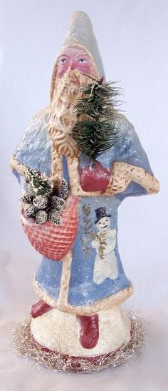 Snowy Sebastian. Paper mache Santa with feather Christmas tree sprig. By Kitty Forseth-Nikolai of Sweet Invocations.