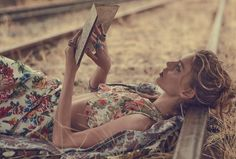 Ondria Hardi lounges in a floral crop top and skirt as she reads a book for Vogue Australia March 2016 issue