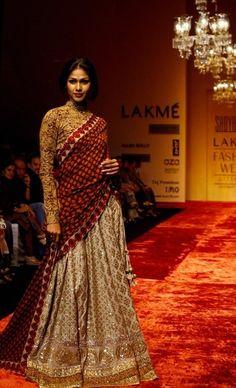 Cream half saree with gold work paired with high neck full sleevs kalamkari blouse by Sabyasachi Mukherjee