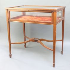 """Lot 850, An Edwardian crossbanded and inlaid rectangular bijouterie table, raised on square tapered legs 29""""h x 27"""" x 17 1/2""""d, est £100-200"""