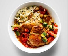 """Moroccan Stewed Chicken from Women's Health Magazine:    You might think you have to cook all day for this flavorful dish—but you can get the rich """"stewed"""" taste in just 30 minutes. The chicken loads this dish with protein, but the veggies and legumes keep it well-balanced. Serve it with 1/2 cup cooked couscous tossed with golden raisins, toasted pine nuts, and chopped cilantro."""