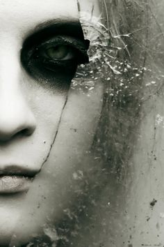 glass crack and Portrait with black eye make-up