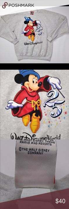 1996 vintage walt Disney world Sweatshirt 1996 vintage walt Disney world Sweatshirt. This is a RARE find and absolutely in great condition. Authentic Disney Mickey inc made exclusively for Walt Disney theme parks. It is a size Medium (men's) but can be oversized for the ladies and in great condition! Disney Sweaters Crewneck