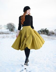 full yellow skirt with black tights, ankle boots, slash neck sweater and beret