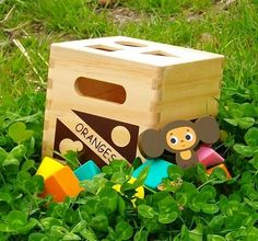 Wooden box with shapes and monkey too.