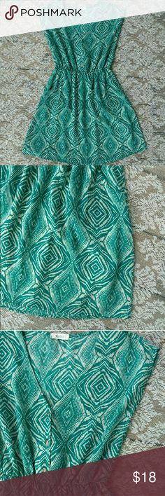Everly Teal Diamond Patterned Dress Gorgeous teal and white dress from Nordstrom. V-neck. 3 buttons in front. Pockets. Stretchy waist. Size medium. 34 inches long. 19 inches from pit to pit laying flat. 12 inches across waist laying flat without stretching. Everly Dresses