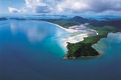 """Whitehaven Beach is a definite """"must-see"""" in the Whitsundays (Australia). The crystal clear aqua waters and pristine silica sand of Whitehaven stretch over seven kilometres along Whitsunday Island , the largest of the 74 islands in the Whitsundays. It defines nature at its best and provides the greatest sense of relaxation and escape."""