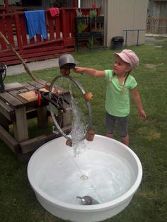 Using an old bike wheel for water play.