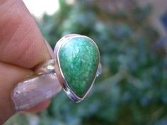 Maw sit sit, also known as jade-albite, is a gemstone found exclusively in northern Burma. Typically maw sit sit is green with distinctive dark-green to Jade Ring, Jade Green, Aud, Sterling Silver Rings, Gemstone Rings, Gemstones, Jewellery, Natural