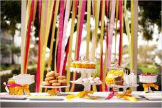 Pink, yellow & orange ribbon dessert table/buffet