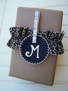 **monogram** If your a scrapbooker or stamper ..... you'll have letter stamps handy and all sorts of paper shapes and colors in your a scrapbooker. Cute idea on nicer gift wrap! :)