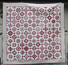 we love red-and-white quilts.  This Nearly Insane quilt is by Hanne in Norway