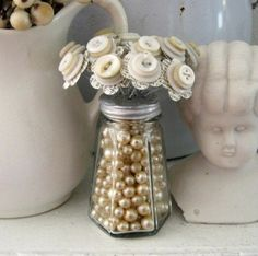 Button flowers in a vintage salt shaker filled with beads