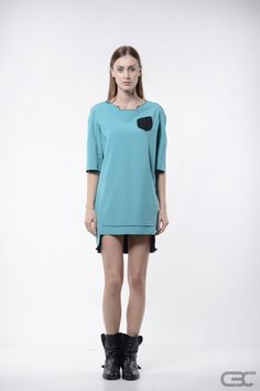 http://cbcdesign.ro/en/shop/dress-deep/  Short dress with square neckline and 3/4 sleeves. The dress has a raw square-ish decoupage finish – apparently unfinished – on the neckline, hemline and at the sleeves. The front has a lasercut faux pocket.