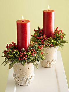 Berry-Trimmed Candles  Create these fresh red-and-green candle arrangements in a flash. Simply tuck pieces of wet florist's foam into two pots, add a bit of greenery and some hypericum berries (available from most florists), and finish the display with festive holiday-hue candles.