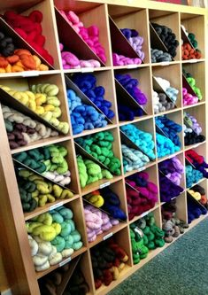 Take a trip to Ikea and pick up some thin hard board on the way back > this is how to organize yarn :)