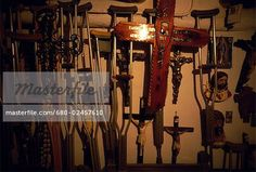 Crutches and crosses mounted on a wall, Santa Fe, Chimayo, New ...