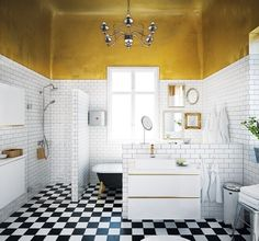 Gold ceiling black and white bathroom