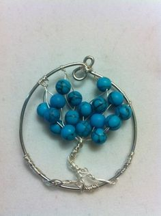 Handcrafted Turquoise stone beaded Tree of Life Pendant.  Available for auction on Ebay!