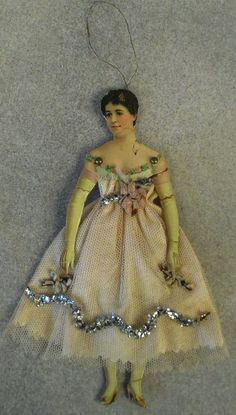 Victorian lady Christmas tree ornament, scrap paper, satin and tulle dress decorated with flowers and tinsel, 6 in. high, from the Vivian Copeland Collection in Wilmington.