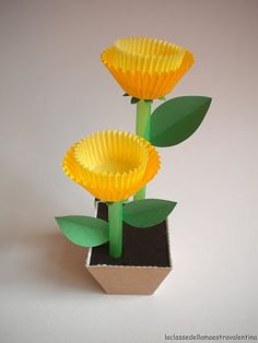 Daffodils craft. These would be cute as a centerpiece for a table at Easter. You could fill the baking cups with yellow jellybeans, if the cups will support the weight....