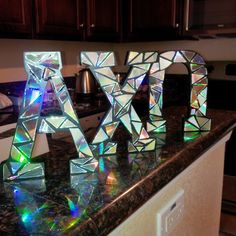 Wooden letters covered in cut up CDs, a new take for our musical sorority <3